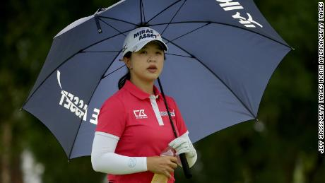 World No.6 Sei Young Kim uses a umbrella to protect herself from the sun during the first round of the ANA Inspiration.